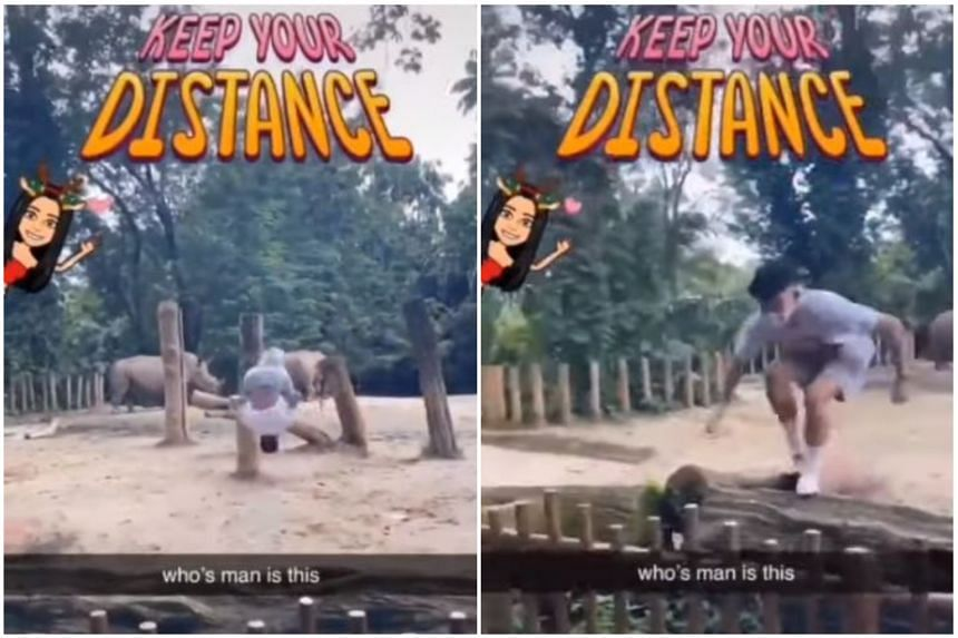 The video showed the man doing a backflip in the rhino enclosure before running out.
