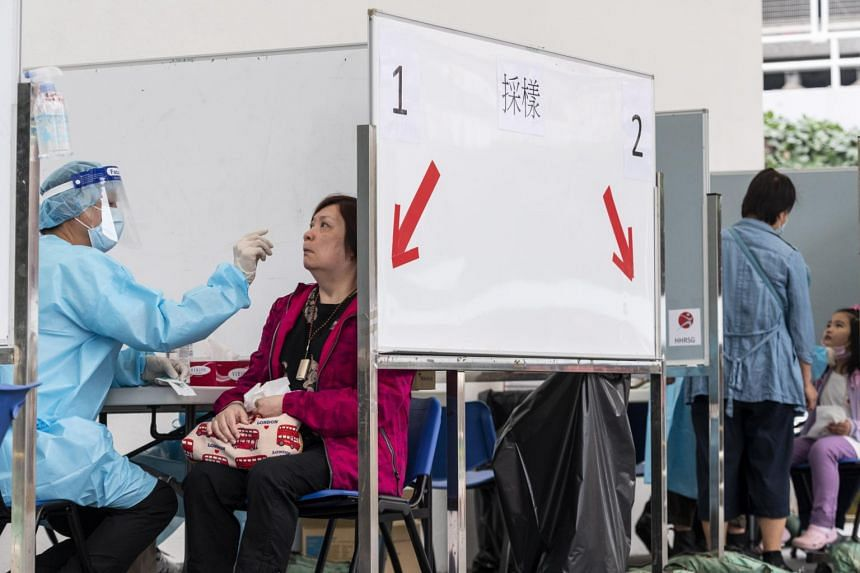 Visitors receive PCR tests for Covid-19 at a Community Testing Centre in Hong Kong on Dec 12, 2020.