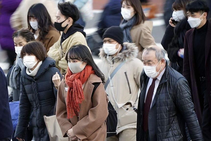Tokyo raised its Covid-19 alert level to the highest of four stages on Thursday as the number of new cases spiked to a record daily high of 822.