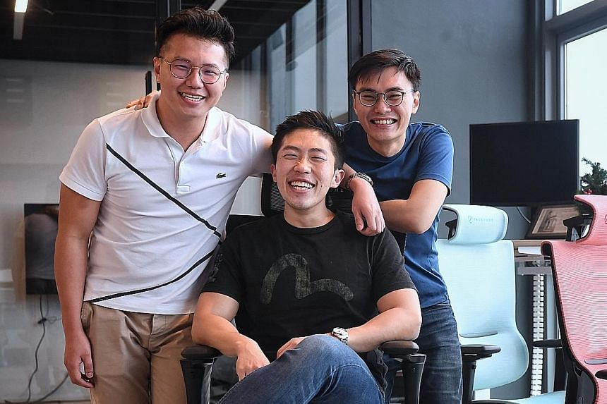 (From far left) TAN JUN KIAT, 30, JOSHUA CHAN, 29, AND LYE YI HAO, 29 Founders of ergonomic office furniture firm Ergo Edge