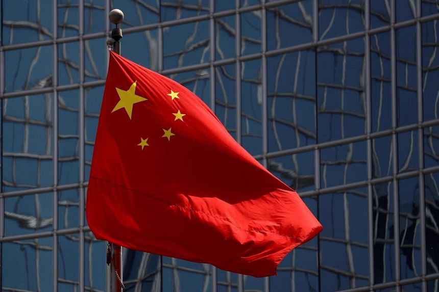 China's state planning agency says the review system is in line with international practice.