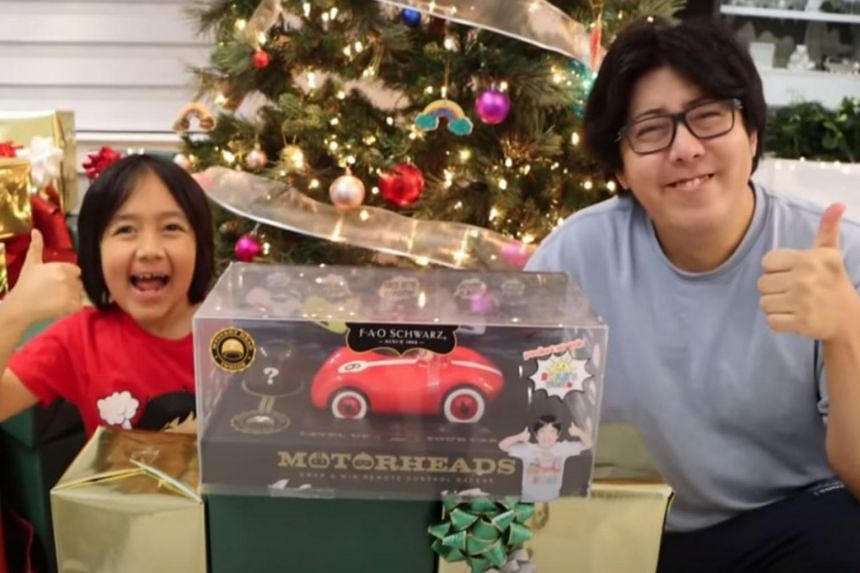 """Ryan Kaji (left) has earned US$29.5m from his """"unboxing"""" videos."""