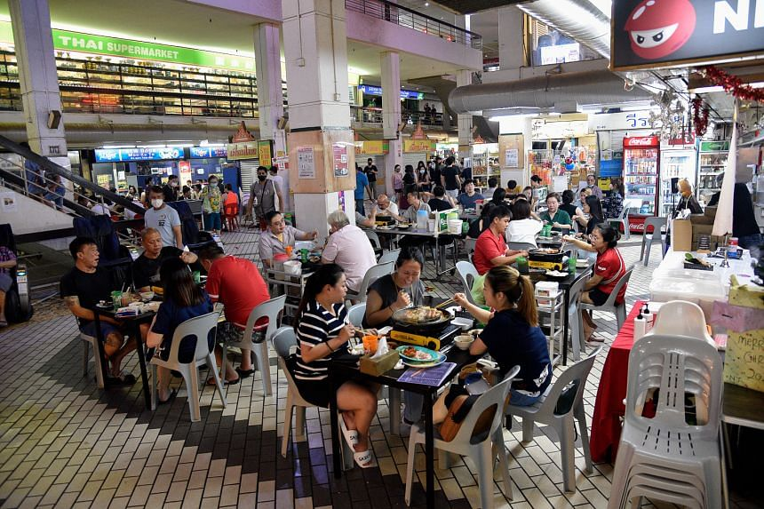 Customers eating at a mookata restaurant in Golden Mile Complex.