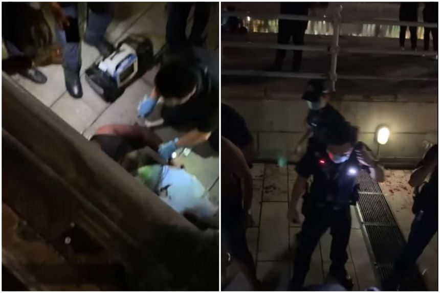 Police officers and paramedics tending to people at the scene of the fight at Clarke Quay.