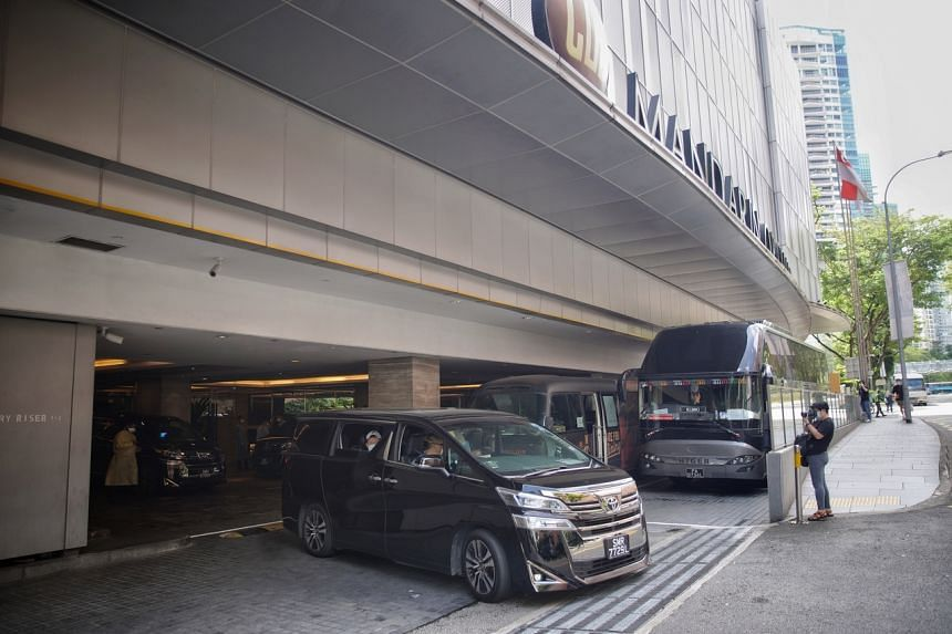 A car ferrying hotel guests leaving the Mandarin Orchard hotel, on Dec 20, 2020.