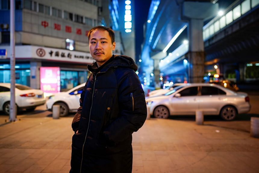 Mr An Junming on the streets of Wuhan, almost a year after the outbreak of Covid-19, on Dec 15, 2020.