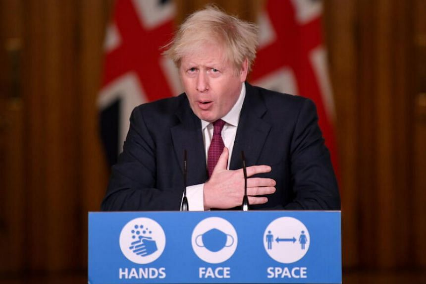 Britain's Prime Minister Boris Johnson speaks during a news conference in response to the ongoing situation with the coronavirus pandemic, inside 10 Downing Street, London , on Dec 19, 2020.