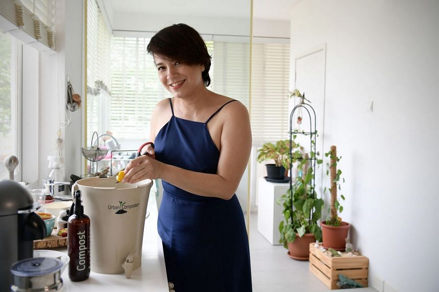 One FM 91.3 DJ Angelique Teo with her compact composter, which is based on a Japanese fermentation method that uses soil containing micro-organisms to cover food waste.