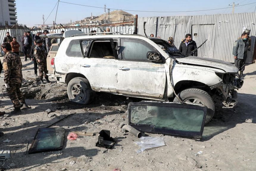 Afghan security officials inspect the site of a bomb blast in Kabul, on Dec 15, 2020.