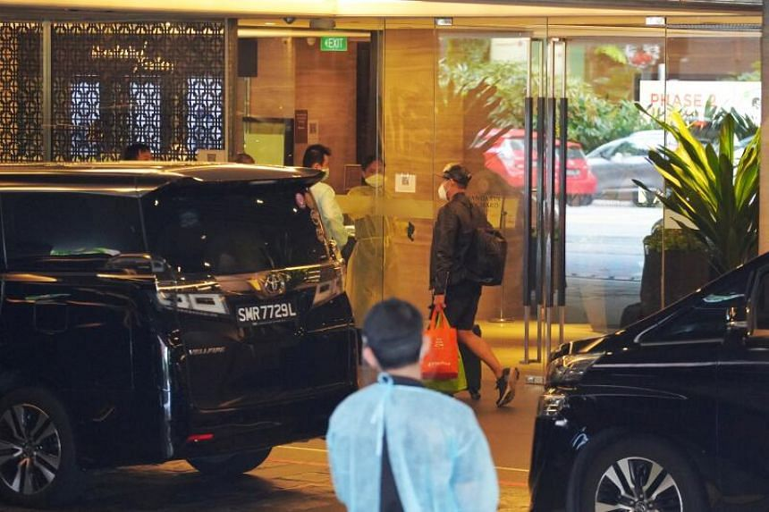 A guest leaving the Mandarin Orchard on Dec 20, 2020, after 13 cases of Covid-19 were found among guests who served their SHN at the hotel.