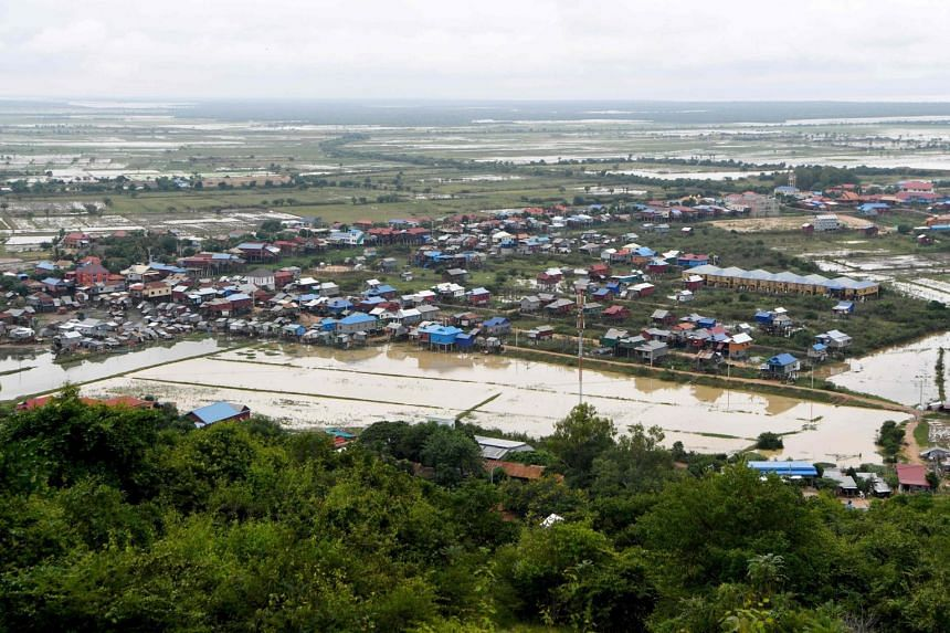The Chong Kneas floating village and rice fields next to the Tonle Sap river in Siem Reap, Camodia, on Oct 16, 2020.
