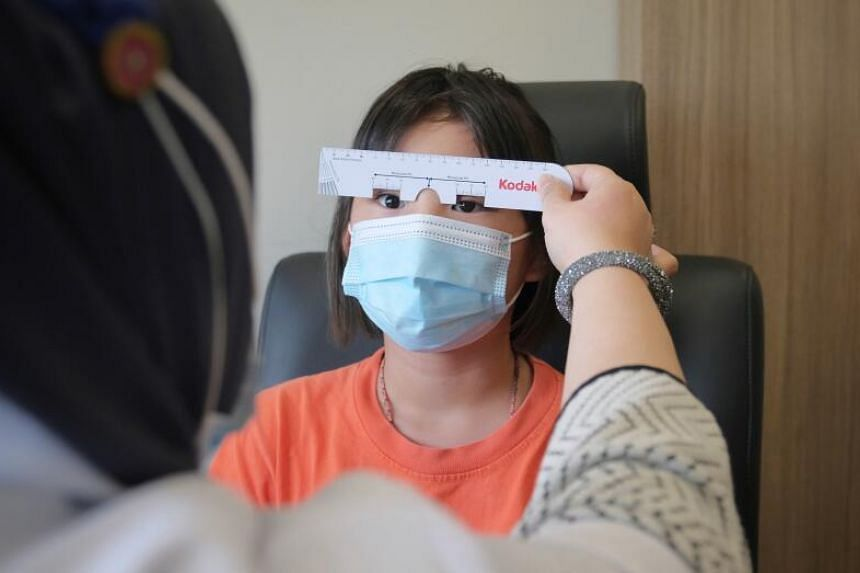 Born with microphthalmia, Claire Lim receives a new eye prosthesis once every five years.