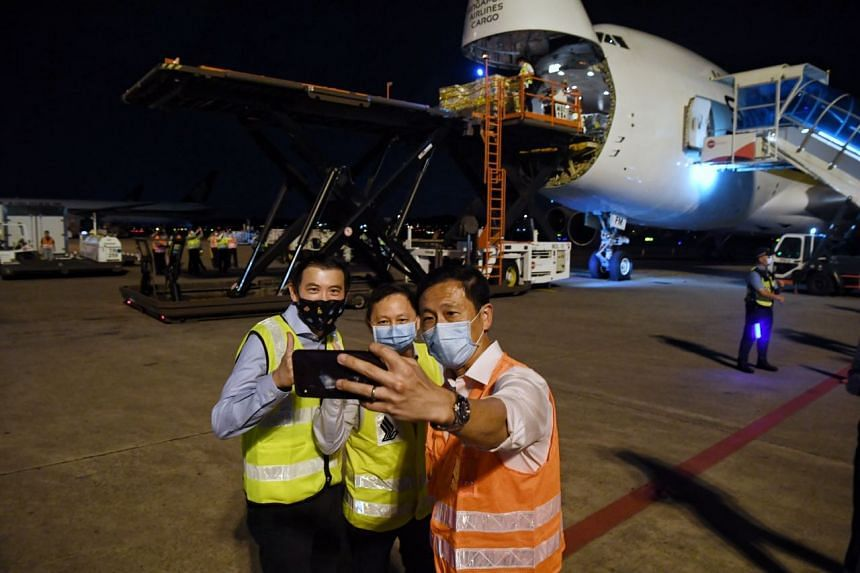 (From right) Transport Minister Ong Ye Kung, SIA chief executive Goh Choon Phong and Changi Airport Group CEO Lee Seow Hiang take a wefie at Changi Airport where the Pfizer-BioNTech vaccine shipment landed on Dec 21, 2020.
