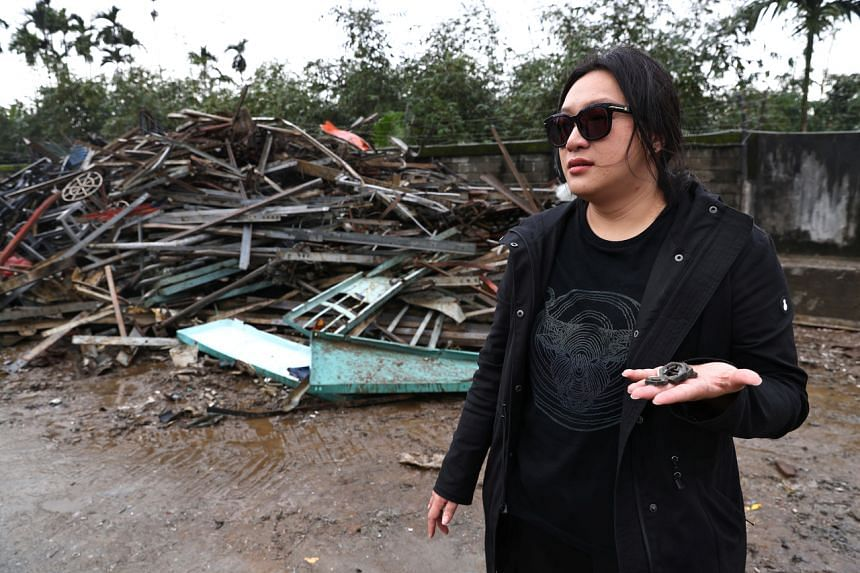Ms Wang Li-ling scours dumps, picking up old bits of metal and wires from Taiwan's main electricity supplier to add extra flair to her clothes.