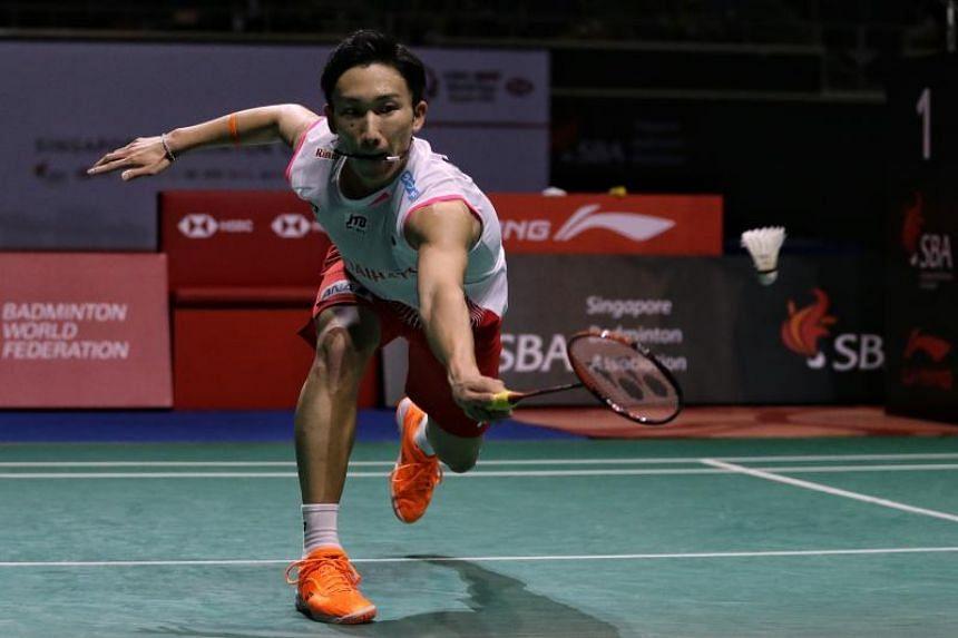 Kento Momota of Japan returning a shot during the Singapore Badminton Open men's singles final at Singapore Indoor Stadium on Apr 14, 2019.