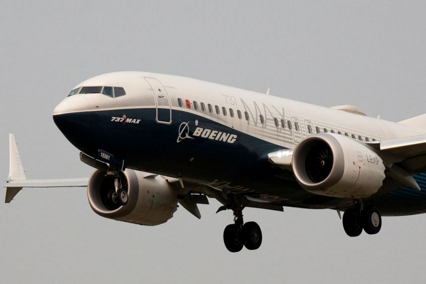 A Boeing 737 Max 7 aircraft lands during an evaluation flight at Boeing Field in Seattle, Washington, Sept 30, 2020.