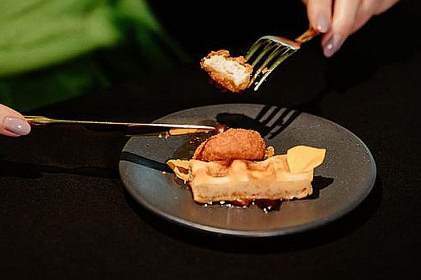 1880's executive chef Colin Buchan (above) and Eat Just's chef Zachary Tyndall prepared a China-inspired bao with sesame cultured chicken (left) and an American-style maple waffle with a cultured chicken nugget (right).