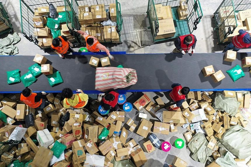Workers sorting packages for delivery at a warehouse in Hengyang in Hunan province on Nov 12, a day after the annual Singles' Day shopping event. Greenpeace estimates that Singles' Day generated 52,400 tonnes of carbon dioxide from manufacturing, pac