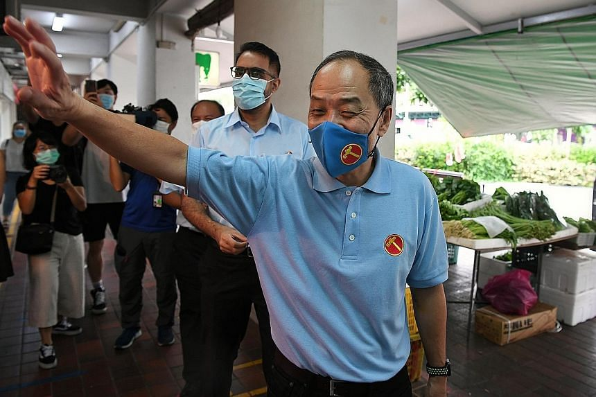 Former Workers' Party chief Low Thia Khiang joining the WP team contesting in Aljunied GRC, led by WP secretary-general Pritam Singh (behind Mr Low), at Hougang Mall on the last day of campaigning on July 8. Former Nee Soon GRC PAP MP Lee Bee Wah tea