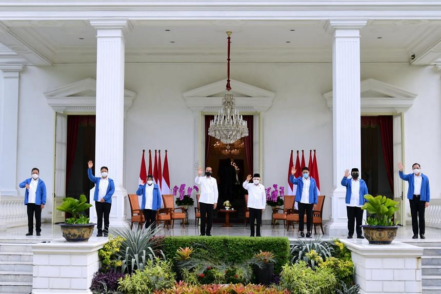 Indonesian President Joko Widodo (centre left) and Vice-President Ma'ruf Amin announce new ministers during a news conference at the Merdeka Palace on Dec 22, 2020.