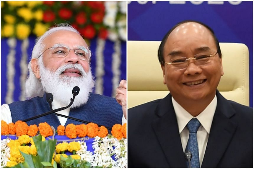 """India Prime Minister Narendra Modi (left) and his Vietnamese counterpart Nguyen Xuan underscored the importance of """"self-restraint"""" and """"non-militarisation"""" of the South China Sea."""