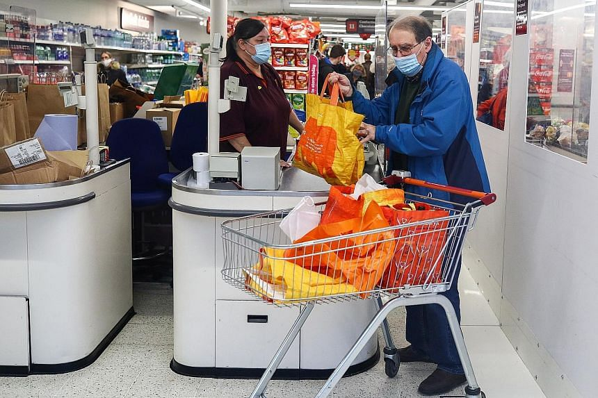 Shoppers at a London supermarket yesterday. The new variant in Britain is one among many that have arisen as the coronavirus spreads worldwide. PHOTO: REUTERS