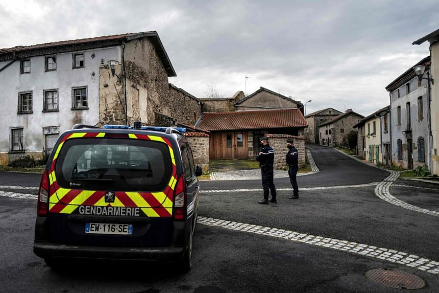 French gendarmes standing guard near where three gendarmes were shot and killed, in Saint-Just, France, on Dec 23, 2020.