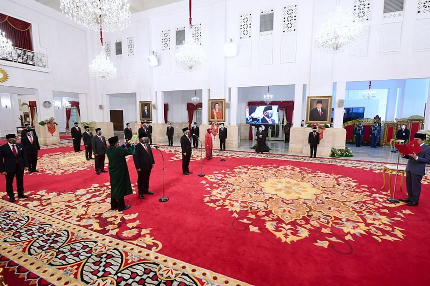 Indonesian President Joko Widodo (right) inaugurating his new ministers at the Merdeka Palace in Jakarta on Dec 23, 2020.