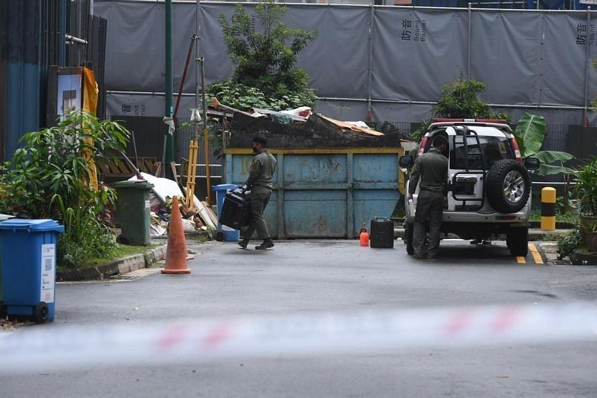 Members of the Singapore Armed Forces' Explosive Ordnance Disposal team entering the site on Dec 22, 2020.