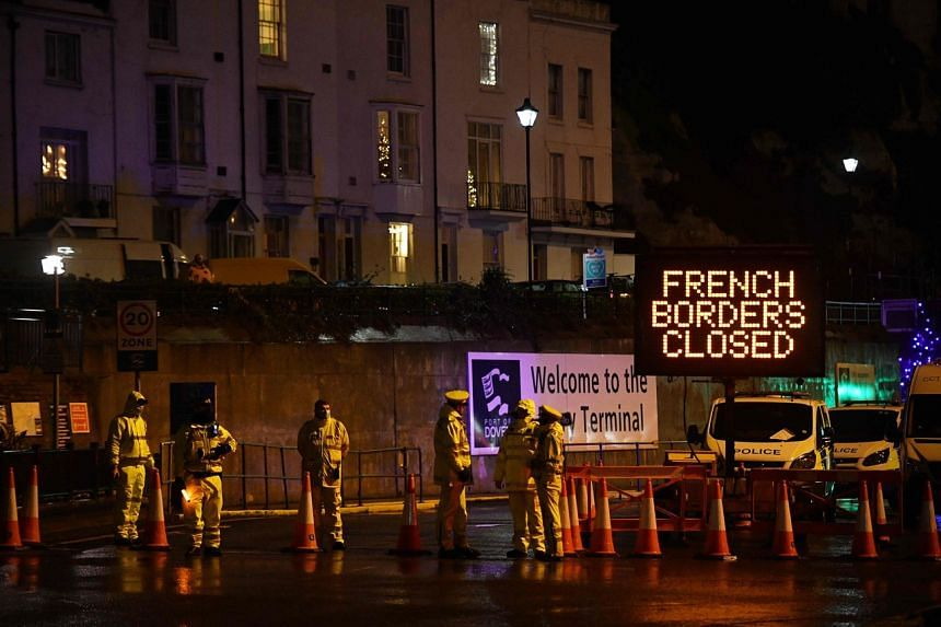 Police officers block access to the port in Dover, England, after France closed its borders, on Dec 22.
