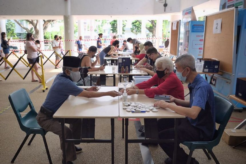 The token distribution exercise at Kampong Kembangan Community Club on Dec 23, 2020.