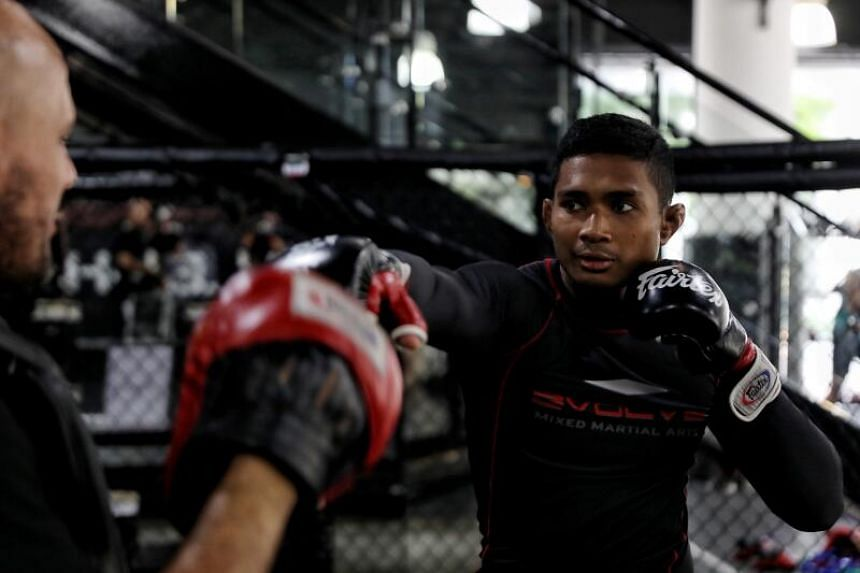 Amir Khan training his punches with his coach at Evolve MMA, on Dec 8, 2020.