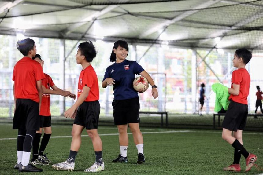 FootballPlus coach Ho Wen Jin chatting with players during at raining session on Dec 18, 2020.