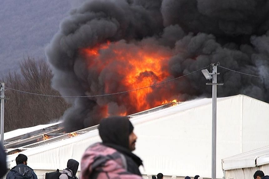 "Migrant camp ""Lipa"" is seen ablaze in Bihac, Bosnia and Herzegovina."