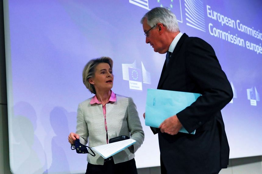 EU chief Brexit negotiator Michel Barnier speaks with European Commission President Ursula von der Leyen following their statement on the outcome of the Brexit negotiations in Brussels on Dec 24, 2020.