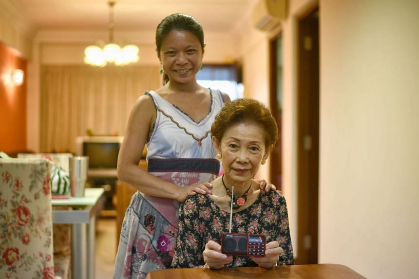 Dr Skye Yeo and her mum, Madam Julie Yen, 78, a housewife, with the Project Audible Cheer MP3 radio..
