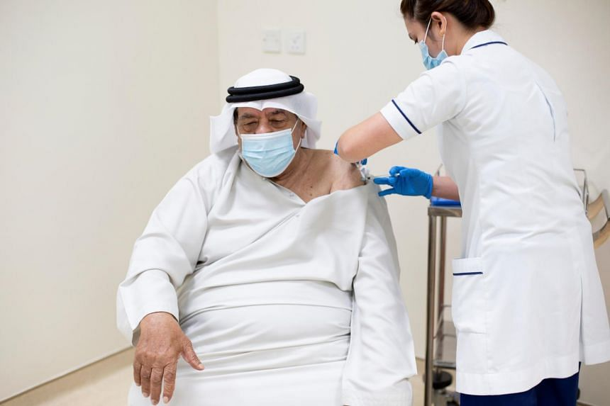 In Dubai, a senior citizen was among the first to get the jab.