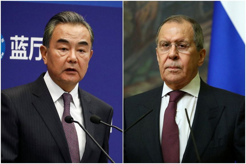 Chinese Foreign Minister Wang Yi (left) and and his Russian counterpart Sergei Lavrov spoke on Dec 22 in the second phone conversation since November.