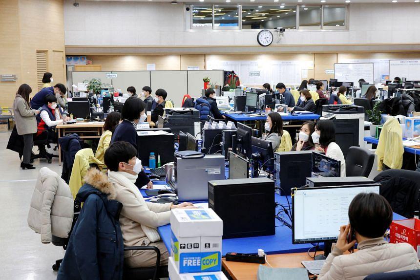 City employees work at Incheon city's coronavirus response command center in Incheon, South Korea, Dec 18, 2020.