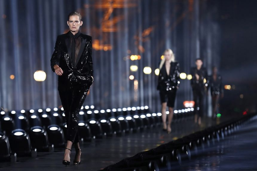 Stella Tennant presents a creation from the Women Spring/Summer 2020 collection by Saint Laurent during the Paris Fashion Week, on Sept 24, 2019.