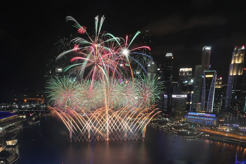 Fireworks lighting up the city skyline during the Marina Bay New Year's Eve countdown last year. There will be no such display at Marina Bay this year, but they will dazzle the skies in HDB towns like Bishan and Bedok instead. Residents are encourage