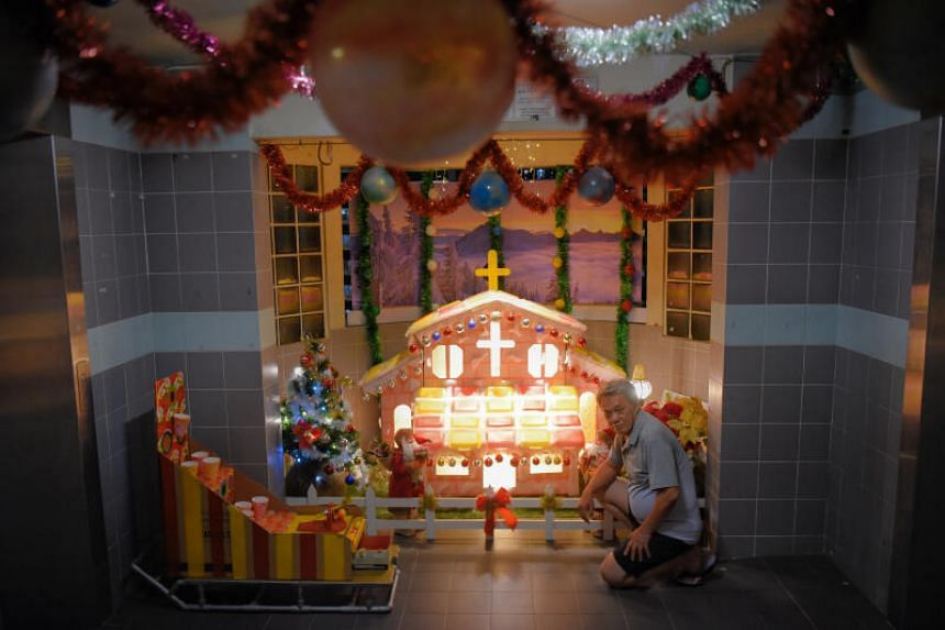 Mr Lim Beng Hua with his yearly Christmas creation at Block 722 Tampines Street 72 on Dec 20, 2020.