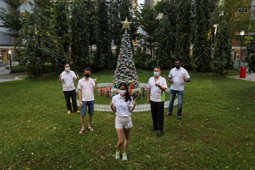 Canberra Grassroots volunteers with the Christmas tree they set up at Block 121 Canberra Street on Dec 18, 2020.