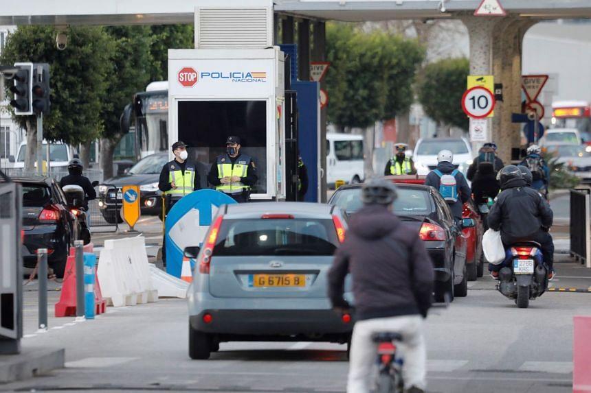Vehicles cross the Gibraltar border from the Spanish side, in the town of La Linea de la Concepcion, Dec 22, 2020.