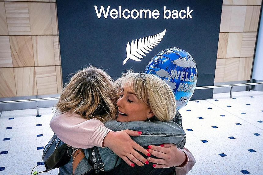 A passenger hugging a family member upon arrival from New Zealand at Sydney Airport in October, after Australia's border rules were relaxed under a new one-way trans-Tasman travel agreement. PHOTO: AGENCE FRANCE-PRESSE Above: SilkAir and Jetstar plan