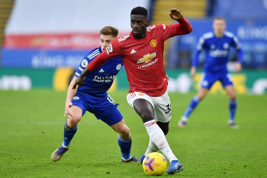 Manchester United's Axel Tuanzebe in action with Leicester City's Harvey Barnes on Dec 26, 2020.