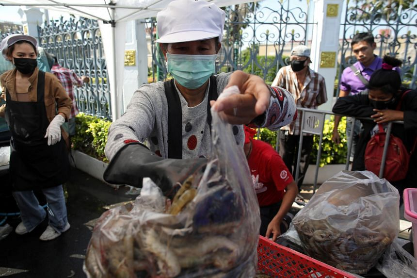 Anti-government protesters sell shrimps in front of government house in Bangkok on Dec 26, 2020.
