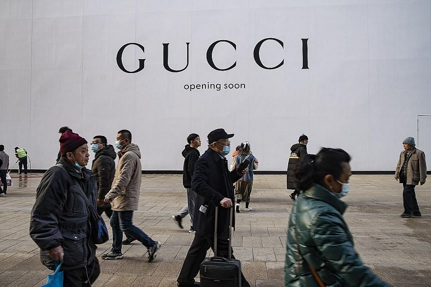 A luxury goods store under renovation in Shanghai, China. The Centre for Economics and Business Research says China looks set for average economic growth of 5.7 per cent a year from next year to 2025, before slowing to 4.5 per cent a year from 2026 t