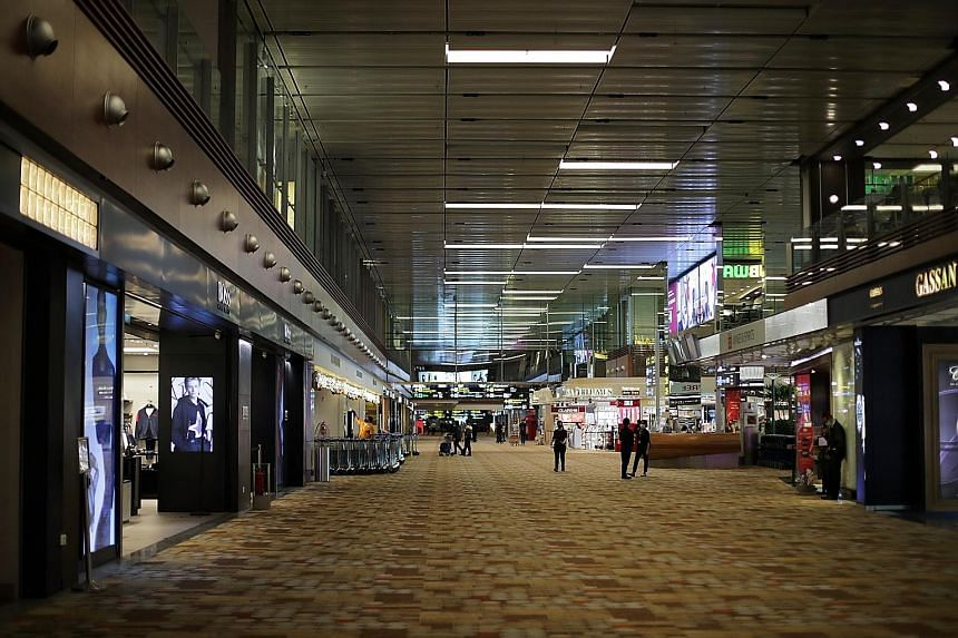 The Ministry of Transport's figures showed that passenger movement at Changi Airport in April plummeted to 0.004 per cent of what it was at the start of the year. Air passenger numbers have been creeping up since then. ST PHOTO: GIN TAY