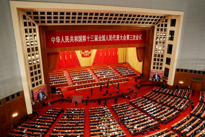 Chinese officials and delegates attend the closing session of the National People's Congress at the Great Hall of the People in Beijing on May 28, 2020.